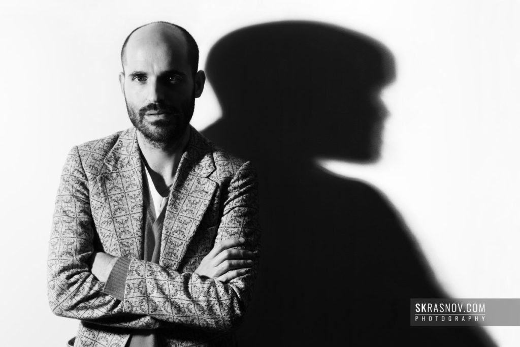 Jose Enrique Ona Selfa, fashion designer. Portrait with shadow © Sasha Krasnov