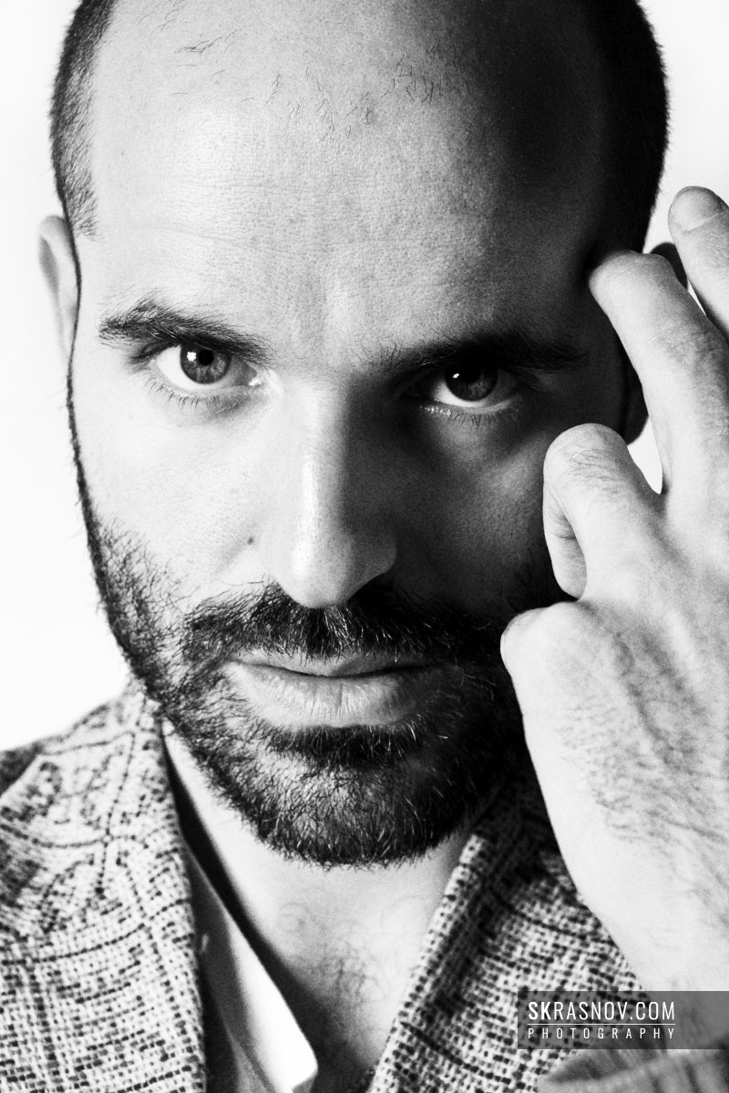 Jose Enrique Ona Selfa, fashion designer. Closeup portrait with hand © Sasha Krasnov