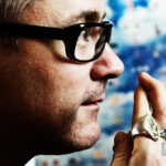 "Damien Hirst , artist, opposite to ""New Religion"" artwork © Sasha Krasnov - Portrait Photographer"