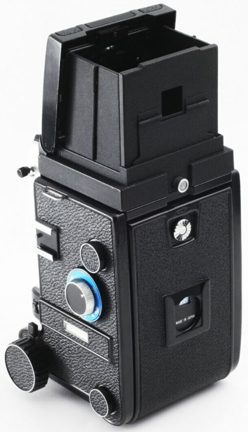 Mamiya C330f equipped with film back and waist-level viewfinder hood