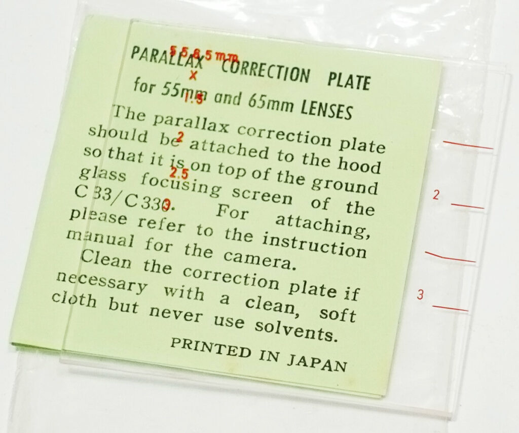 Parallax correction plate for 55mm and 65mm lenses